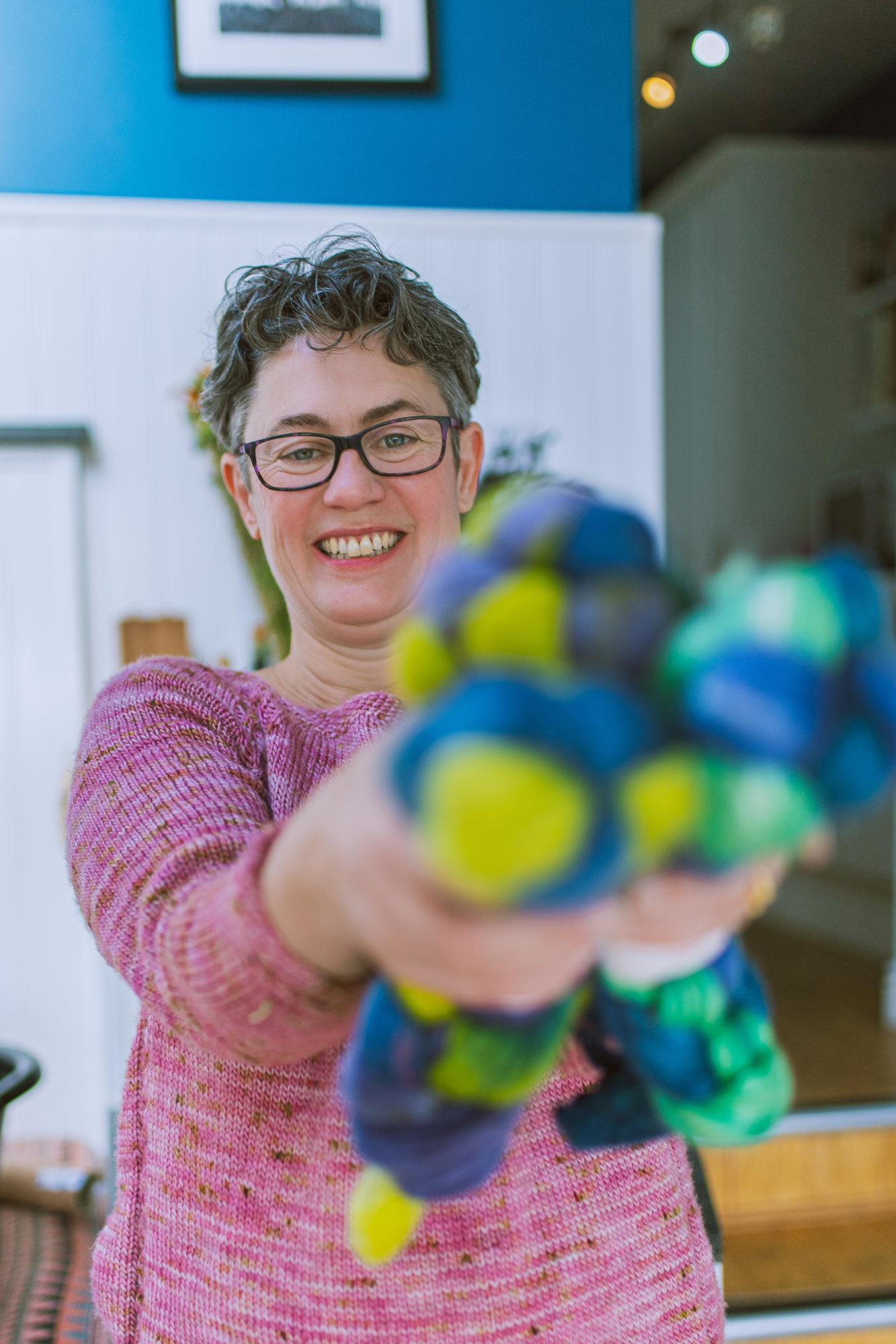 Rachael Prest holds a selecton of coloured fibres for spinning. Photo by Gemma Regalado Bristol Brand photographer